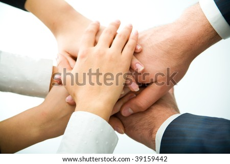 Only hands one on another - stock photo