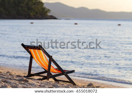 Only wooden chair beach [Wooden deckchair] on the beautiful sandy beach. Tropical beach in summer. Thailand