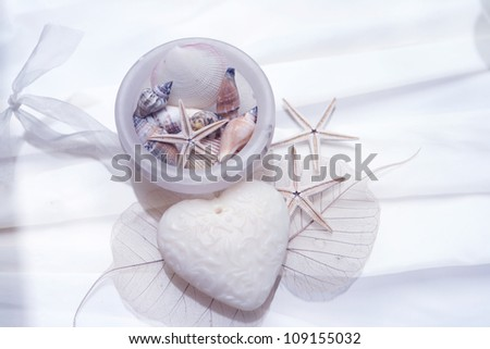 Onyx Bowl with shells, star fish, heart shaped soap and skeleton leaf - stock photo