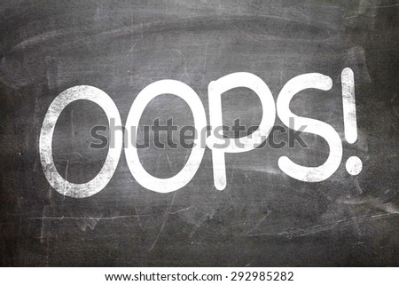 OOPS! written on a chalkboard - stock photo