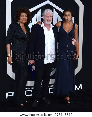Opal Stone, Ron Perlman and Blake Perlman at the Los Angeles premiere of 'Pacific Rim' held at the Dolby Theatre in Hollywood on July 9, 2013 in Los Angeles, California.  - stock photo