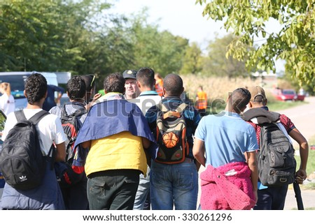 Opatovac, Croatia - October 5, 2015; Refugees entering refugee camp in Opatovac enear the border. They will be here only one day and then they will continue into Hungary.