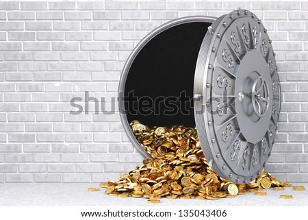 open a bank vault with a bunch of gold coins. - stock photo