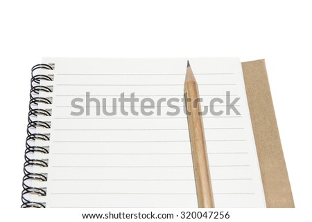 Open a blank notebook and pencils - stock photo