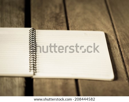 Open a blank white notebook on the table. - stock photo
