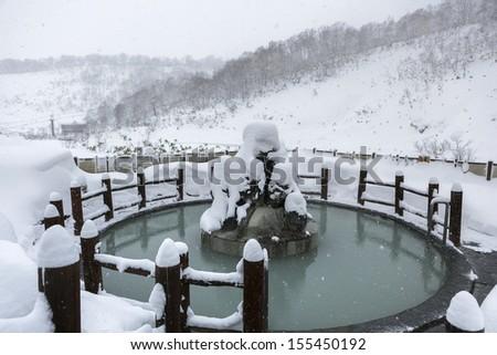 Open air hot onsen in snow winter, Hokkaido, Japan - stock photo