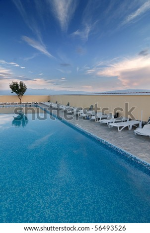 Open air swimming pool with beautiful sky 2 - stock photo