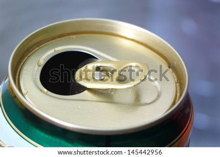 Open aluminum can with water drops  - stock photo