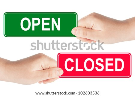 Open and closed traffic sign in the hand on the white background - stock photo