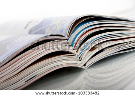 open and stacked magazines - stock photo