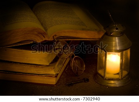 Open antique books the darkness of night - stock photo