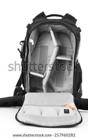 Open backpack of photographer isolated on white - stock photo