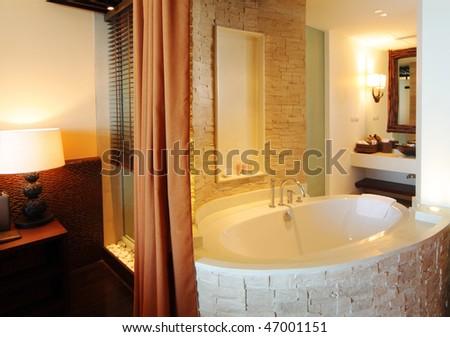 open bathroom including bathtub, basin and mirror - stock photo
