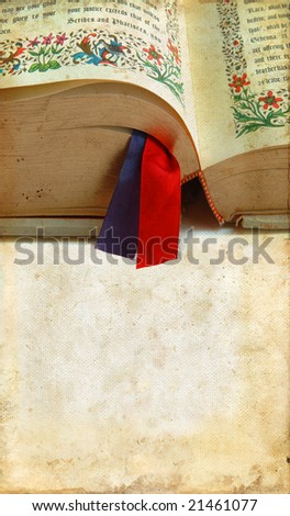 Open Bible with ribbons on a grunge background with copy-space for your text. - stock photo