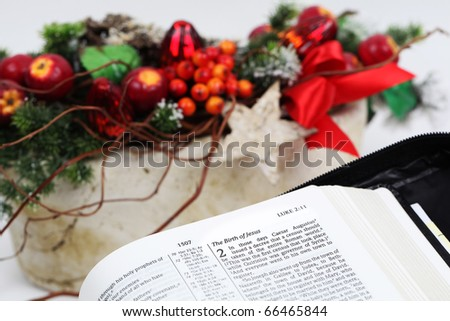 Open Bible with selective focus on text in Lucas 2 about Jesus' birth. Shallow dof - stock photo