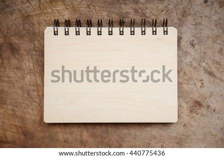 Open blank book on old wooden background