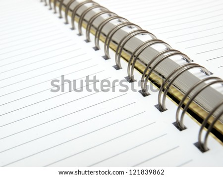 Open blank sheet of a diary with metal spiral binding