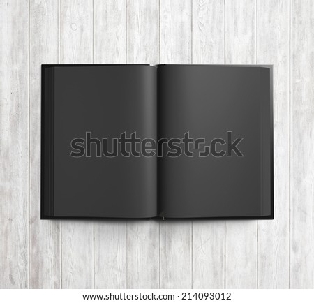 Open blank textbook with black pages - stock photo