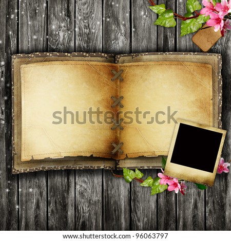 Open blank vintage book on wooden table - stock photo