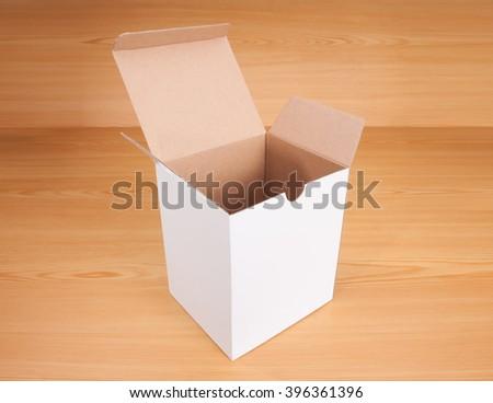 Open blank white box mock up on wood background. - stock photo