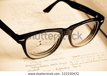 Open book and glasses - stock photo