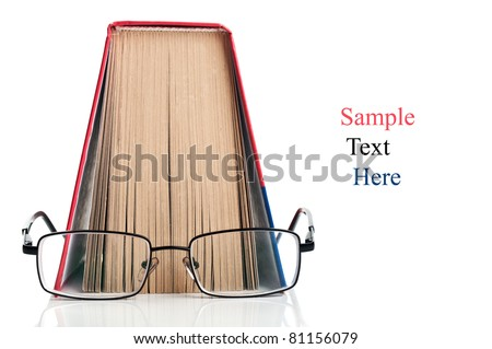 open book and glasses isolated on a white background - stock photo