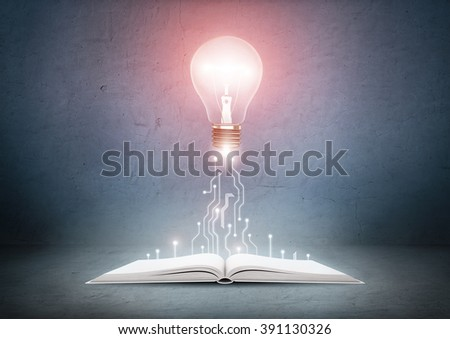 Open book and glowing light bulb over it. Knowledge, education concept - stock photo