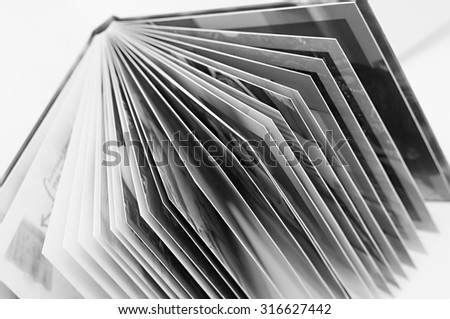 Open book, black and white photo.