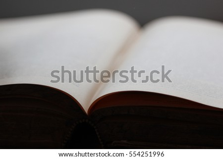 Open book defocused on black background