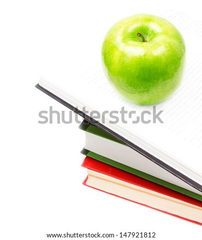 Open Book heap and green apple on top over white background. Concept of education. Closeup - stock photo