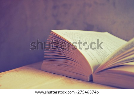 open book in vintage light tone color - stock photo