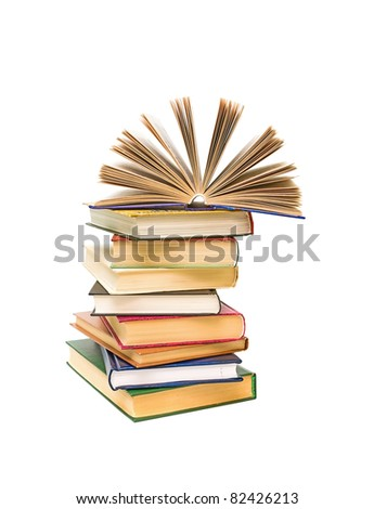 open book on a pile of books closeup isolated on white background