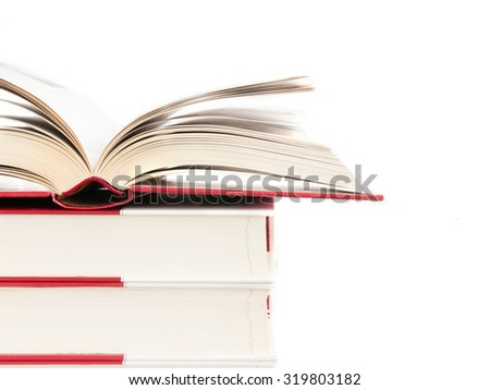 Open book on a stack of books isolated on a white background - stock photo
