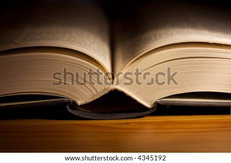 open book on a table with narrow DoF - stock photo