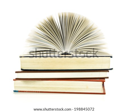 open book on books, on white background.