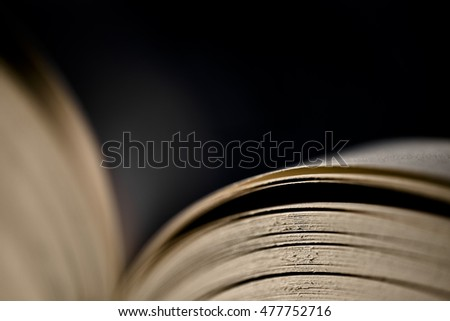 Open book on dark background, focus on pages at the right side