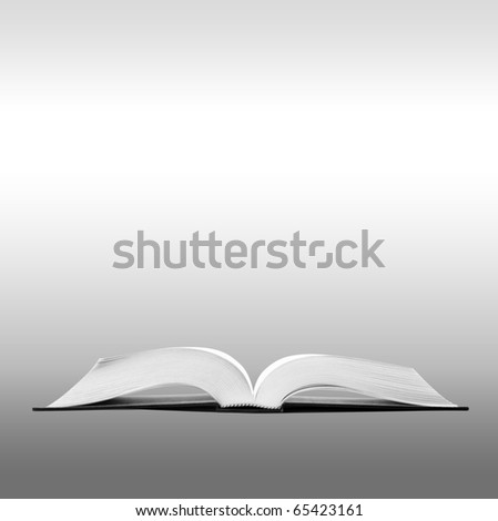 Open book on gray background