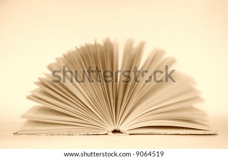 open book on sepia background