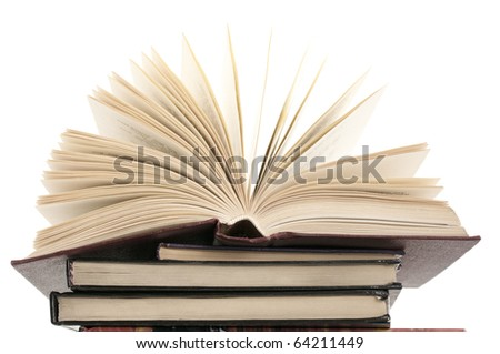 Open book on stack of books against white background.