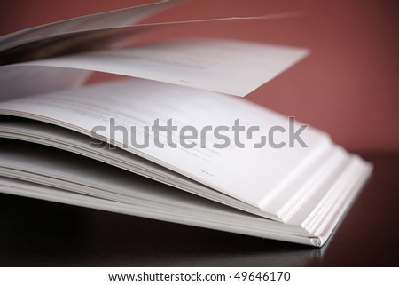 Open book on the wooden desk - stock photo