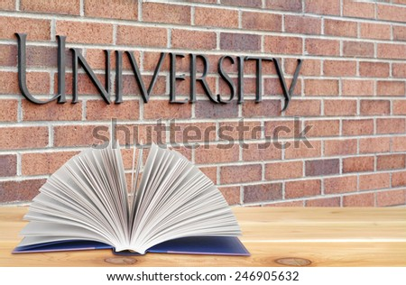 stock-photo-open-book-on-the-wooden-tabl