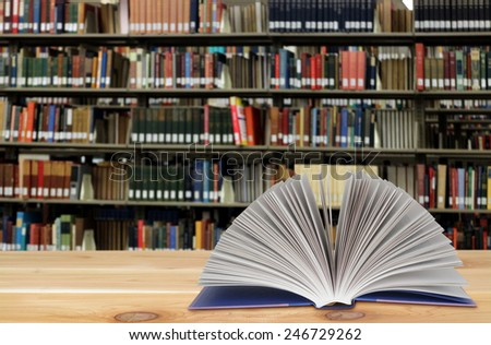 open book on the wooden table isolated on white - stock photo
