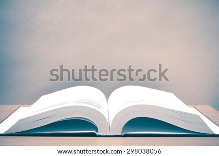 open book on wood background vintage style