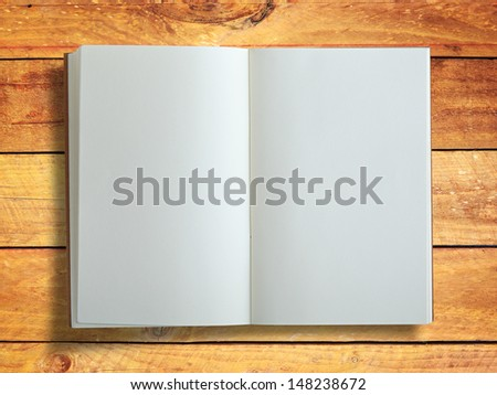 Open book on wood panel background - stock photo
