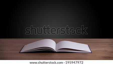 Open book on wooden deck and copy space - stock photo