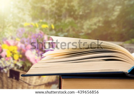 Open book over the blurred landscape background