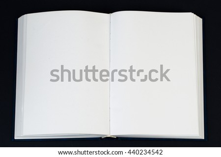 Open book, stack of hardback book on wooden table. Back to school. Copy space. Top view. - stock photo