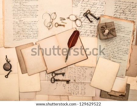 open book, vintage accessories, old letters and documents. sentimental nostalgic background - stock photo