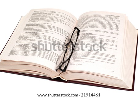 Open book with black glasses - stock photo