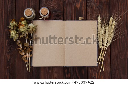 Open book with blank pages and ingredients. Kraft paper. Autumn dry flowers